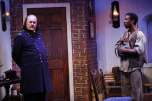 L-R: Ames Adamson (as Benjamin Butler) and John G. Williams (as Shepard Mallory) in Richard Strand's BUTLER, directed by Joseph Discher, at 59E59 Theaters. Photo by Carol Rosegg